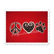 Peace Love and Paw stitched by Shannon Bazo